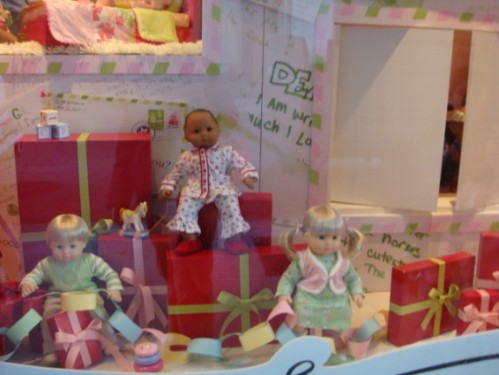 American Girl dolls in window display
